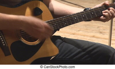 acoustic guitar 7 - playing acoustic guitar