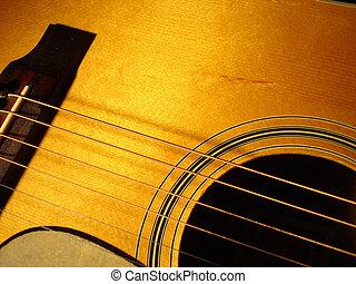 Acoustic Guitar - Close view of an acoustic guitar