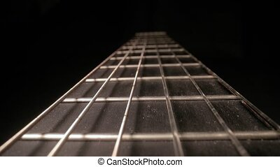 Acoustic guitar fretboard macro closeup slider shot