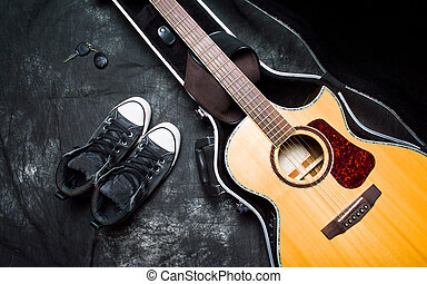 Acoustic guitar in a case on dark background
