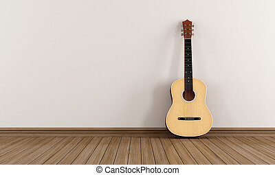 Acoustic guitar in a empty room - Acoustic guitar leaning...