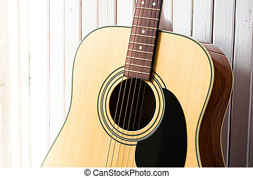 acoustic guitar on a white wooden background close-up