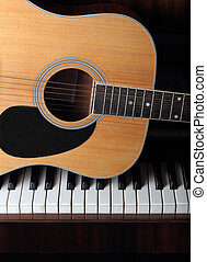 acoustic guitar on old piano keys