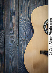 Acoustic guitar part on the background of textured boards.