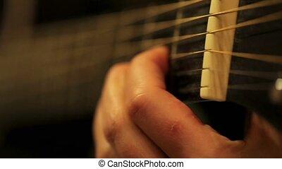 Acoustic guitar playing, close up shot