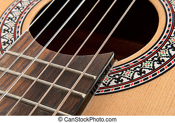 Acoustic guitar strings - Close up and low level of acoustic...