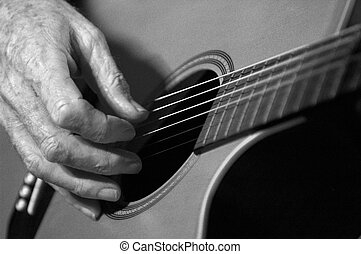 Acoustic Guitarist - A black and white photo of someone ...