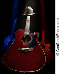 three acoustic guitars on the stage lit with the overhead lights , against black background, useful for music and entertainment themes