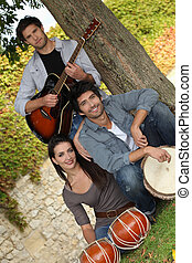 Acoustic musical group in park