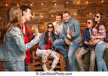 Acquaintance and flirtation. A woman and a group of men....