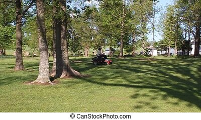 Acreage To Mow - This is my wife mowing our lawn. It will...