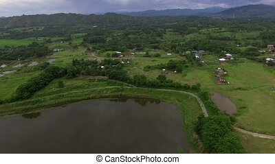 Acres of huge man made fishpond in the lowland valley. drone...