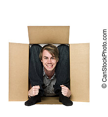 Acrobat inside of a cardboard box.