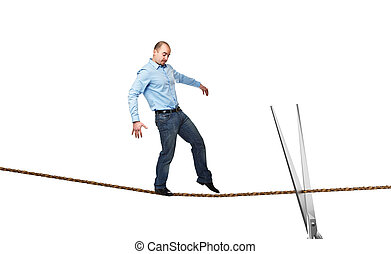 acrobat on rope - young businessman try to walk on rope and...