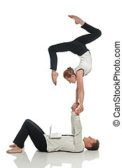Acrobatic business people doing handstand in pair, isolated on white