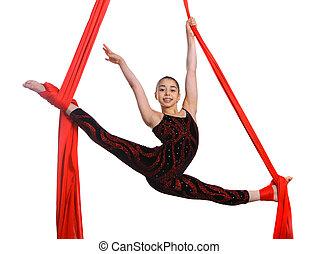 acrobatic gymnastic girl exercising on fabric rope -...