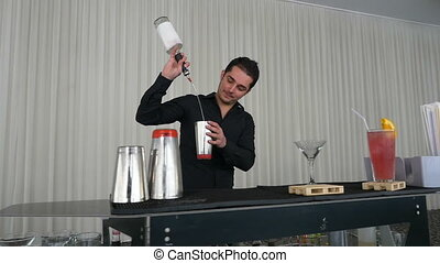 Acrobatic show with shaker made by bartender using flair...