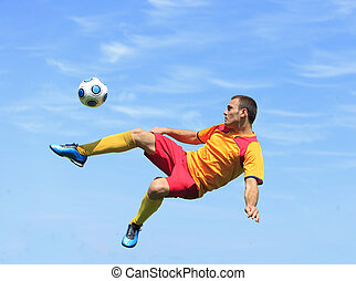 Acrobatic soccer player - A soccer player kicking the ball...