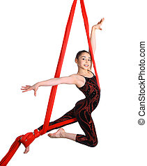 acrobatic gymnastic girl exercising on red fabric rope, isolated on white background