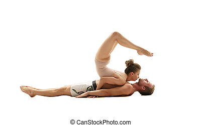Acrobatics. Girl performs trick on man lying down