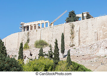 Acropolis, Athens, Greece - October 24, 2017: Many tourists from different nations visit the Parthenon temple on the Acropolis hill.