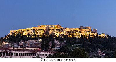 Acropolis of Athens Greece rock and Parthenon illuminated,...