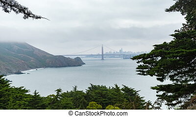 Across San Francisco Bay Time-Lapse - Framed by trees, San...