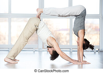 acroyoga balancing stick yoga pose group of two