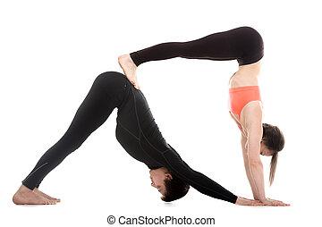Acroyoga, downward-facing dog yoga pose - Two sporty people...