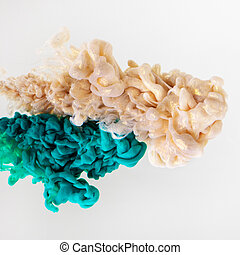 Acrylic colors in water on white background.