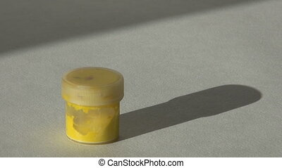 Acrylic gouache yellow paint. Homework, the artist works. hd...