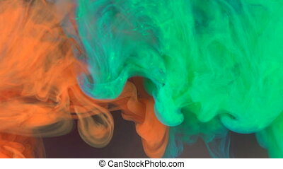 Acrylic paints spread in water. Background from multi-colored paints