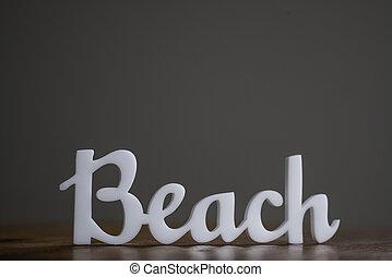 Acrylic Word Beach on Wooden Table