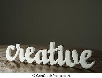 Acrylic Word CREATIVE on Wooden Table