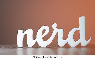 Acrylic Word Nerd on Wooden Table