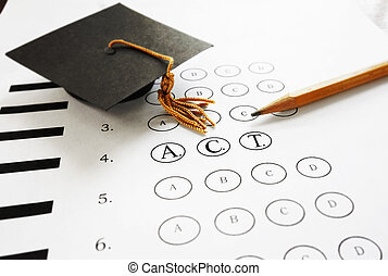 ACT college entrance test with pencil and graduation cap