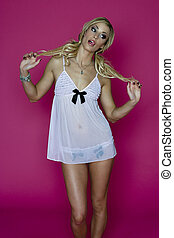 Acting like a child - young woman wearing some racy white ...