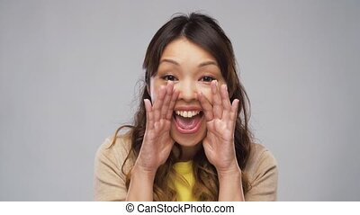 asian woman shouting or calling for someone - action and...