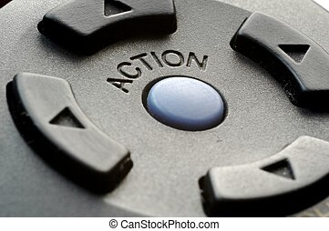 Action button on remote control. Closeup.