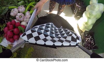 Action camera PoV: Local farmers market tour. Senior woman...