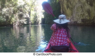 Action Camera POV Of Woman Kayaking In Beautiful Lagoon Back Rear View Girl Paddling On Kayak Boat