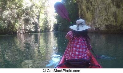 Action Camera POV Of Woman Kayaking In Beautiful Lagoon Back...