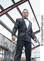 Action hero - Low angle view of handsome courageous male...