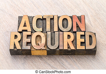 Action required - banner in wood type