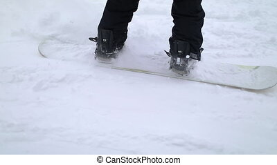 Action Shot of Snowboarder Skiing Down the Hill - Action...