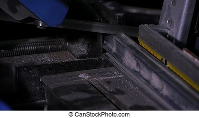Action shot of speeding industrial bandsaw blade with...