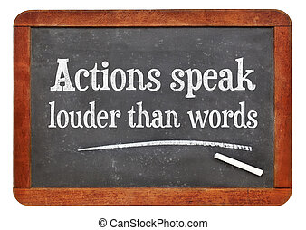 Actions speak louder than words proverb - white chalk text...