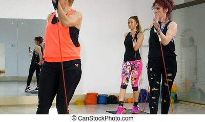 Active adults working out at the fitness club