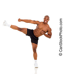active african muscular man kicking