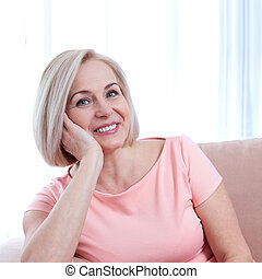 Active beautiful middle-aged woman smiling friendly and looking